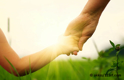 49025614 - hands of mother and daughter holding each other on field